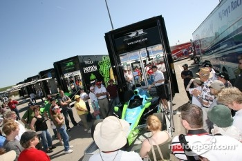 Fans watch as a Rahal Letterman Racing back up car is loaded