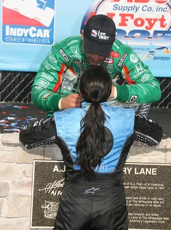 Podium: race winner Tony Kanaan celebrates with Danica Patrick