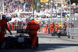 Vitaly Petrov, Lotus Renault GP, has a crash with Jaime Alguersuari, Scuderia Toro Rosso