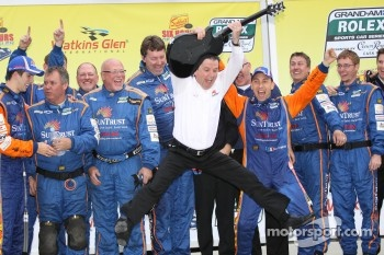 Victory lane: Wayne Taylor leaps off the podium like a rock star