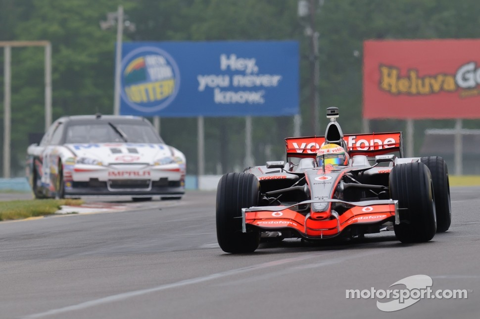 Lewis Hamilton in his McLaren MP4-23 and Tony Stewart in his Chevy Impala Sprint Cup car