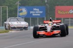 lewis-hamilton-in-his-mclaren-mp4-23-and-tony-stewart-in-his-chevy-impala-sprint-cup