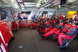 Audi Sport team members watch the race