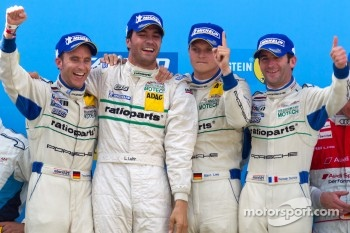 Podium: race winners Marc Lieb, Lucas Luhr, Romain Dumas, Timo Bernhard