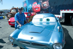 Cars creator John Lasseter posing with his creations