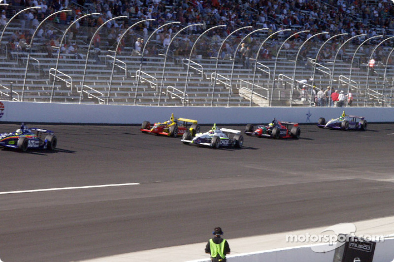 A gaggle of cars on track