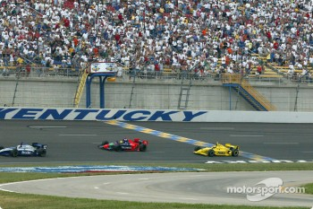 Felipe Giaffone taking the checkered flag in front of Sam Hornish Jr.