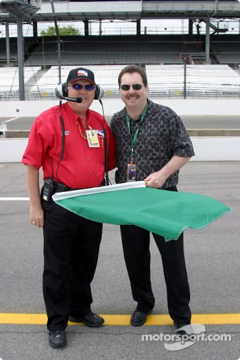 Mike Aulby, professional bowler, has the honors of waving the green flag to start the days practice during a practice session for the 87th running of the Indianapolis 500