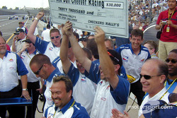 Group of mechanics excitedly waving a giant novelty check worth $30,000 over their heads