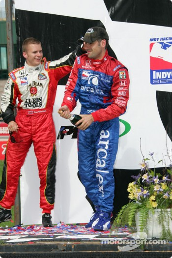 Victory lane: race winner Dario Franchitti celebrates with Dan Wheldon