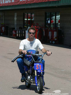 Alex Barron rides to his pit stall