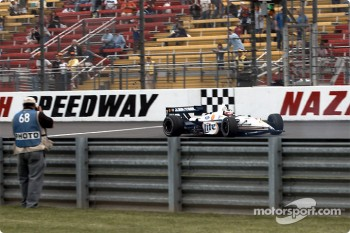 Max Papis in trouble and crossing the start/finish line in reverse