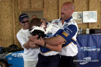 Alex Tagliani gives his crew chief Roy Wilkerson, a birthday cake with help from mechanic Robbie Page