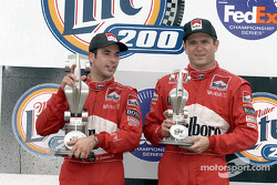 The podium: Helio Castroneves and Gil de Ferran