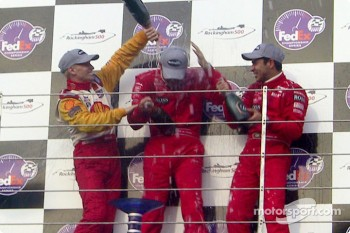 Champagne for Gil de Ferran, Kenny Brack and Helio Castroneves