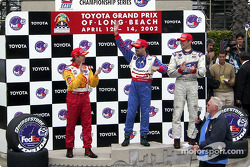 The podium: race winner Michael Andretti, with Jimmy Vasser and Max Papis