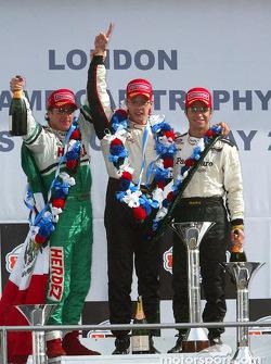 The podium: race winner Sébastien Bourdais with Bruno Junqueira and Mario Dominguez