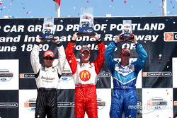Podium: race winner Sébastien Bourdais with Bruno Junqueira and Paul Tracy