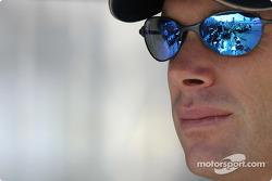 Mario Haberfeld looks at his car