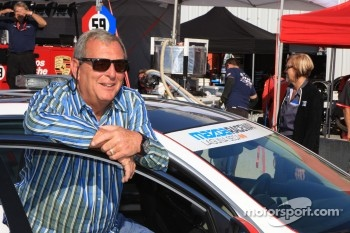 Golf great Fuzzy Zoeller about to take a ride in a pace car around Mazda Raceway Laguna Seca