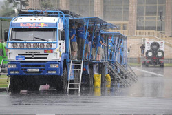 Kamaz team waiting in the rain.