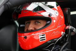 Michael Schumacher, Mercedes GP drives a Mercedes SLS