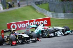 Vitaly Petrov, Lotus Renault GP and Michael Schumacher, Mercedes GP F1 Team