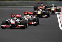 Jenson Button, McLaren Mercedes leads Lewis Hamilton, McLaren Mercedes