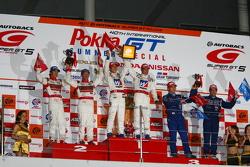 GT500 class podium: winners Takashi Kogure, Loic Duval, second place Masataka Yanagida, Ronnie Quintarelli, third place Tsugio Matsuda, Joao Paulo de Oliveira