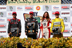 Podium: race winner Will Power, Team Penske, second place Helio Castroneves, Team Penske, third place Ryan Briscoe, Team Penske