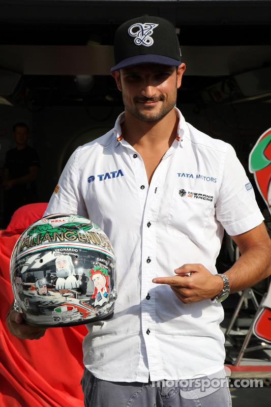 Vitantonio Liuzzi, HRT F1 Team, shows his special new helmet for this Italian Grand Prix