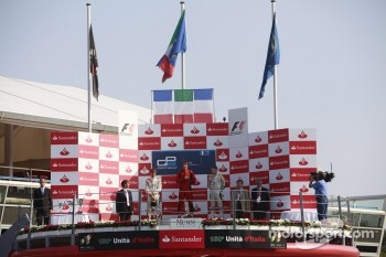 Luca Filippi celebrates his victory on the podium with Charles Pic and Romain Grosjean