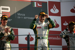Valtteri Bottas celebrates victory in the race and winning the drivers championship on the podium with James Calado and Rio Haryanto