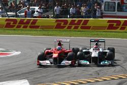 Fernando Alonso, Scuderia Ferrari and Michael Schumacher, Mercedes GP F1 Team
