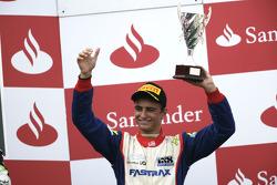Nico Muller celebrates on the podium