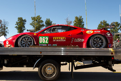 Damaged #062 Risi Competizione Ferrari F458 Italia sits on pitlane during pre-race ceremony