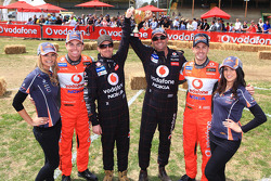 Craig Lowndes and Jamie Whincup after taking part if a lawn mower race