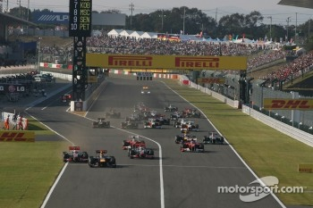 Sebastian Vettel, Red Bull Racing leads the start of the race and leads Jenson Button, McLaren Mercedes
