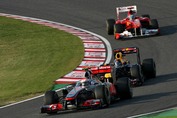 Jenson Button, McLaren Mercedes and Sebastian Vettel, Red Bull Racing