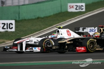Sergio Perez, Sauber F1 Team and Bruno Senna, Renault F1 Team