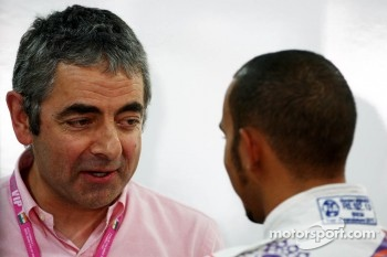 Rowan Atkinson, British actor, talks with Lewis Hamilton, McLaren Mercedes
