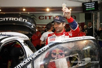 Sbastien Loeb celebrates his eighth world championship