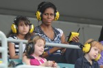 First Lady Michelle Obama watches the race