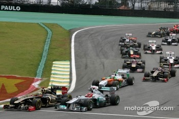 Start of the race, Bruno Senna, Renault F1 Team and Michael Schumacher, Mercedes GP