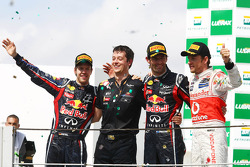Podium: second place Sebastian Vettel, Red Bull Racing, race winner Mark Webber, Red Bull Racing and third place Jenson Button, McLaren Mercedes