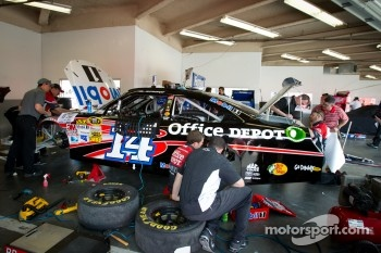Stewart-Haas Racing team members work on the rebuilt Bud Shootout car of Tony Stewart, Stewart-Haas Racing Chevrolet