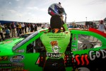 Pole winner Danica Patrick, JR Motorsports Chevrolet gets out of her car after setting the fastest qualifying time