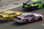 Brad Keselowski, Penske Racing Dodge and Sam Hornish Jr., Penske Racing Dodge battle on pit road