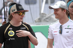 Kimi Raikkonen, Lotus F1 Team and Nico Rosberg, Mercedes GP
