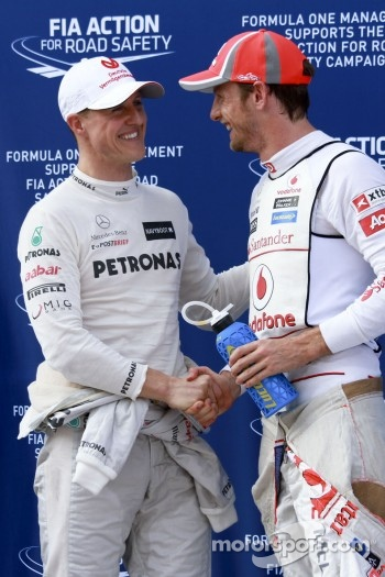 Michael Schumacher, Mercedes GP with Jenson Button, Mclaren